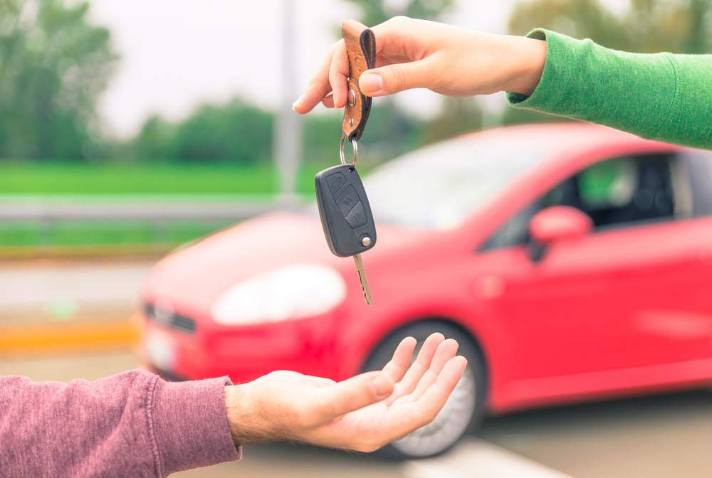 Handing over the car keys to the new owner